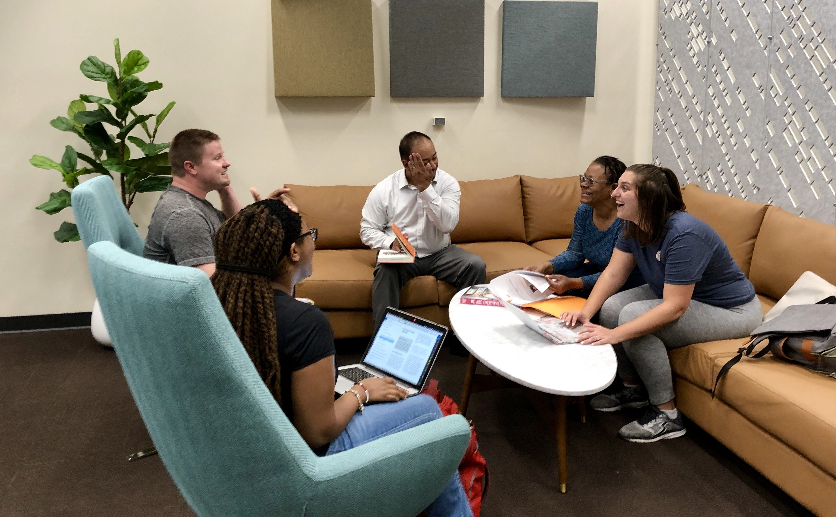 UT graduate students gather for a meeting in the Graduate Commons at Hodges Library