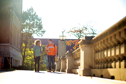 UT students walking on a sidewalk