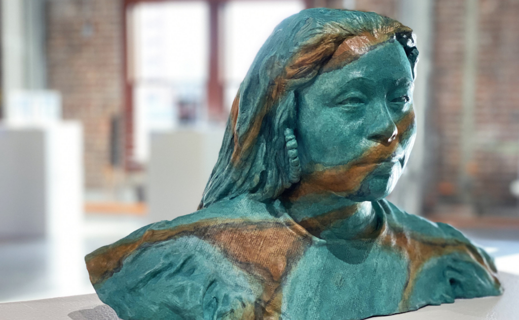 Bronze sculpture of young woman