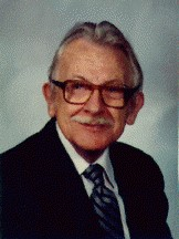 A color portrait of George F. DeVine