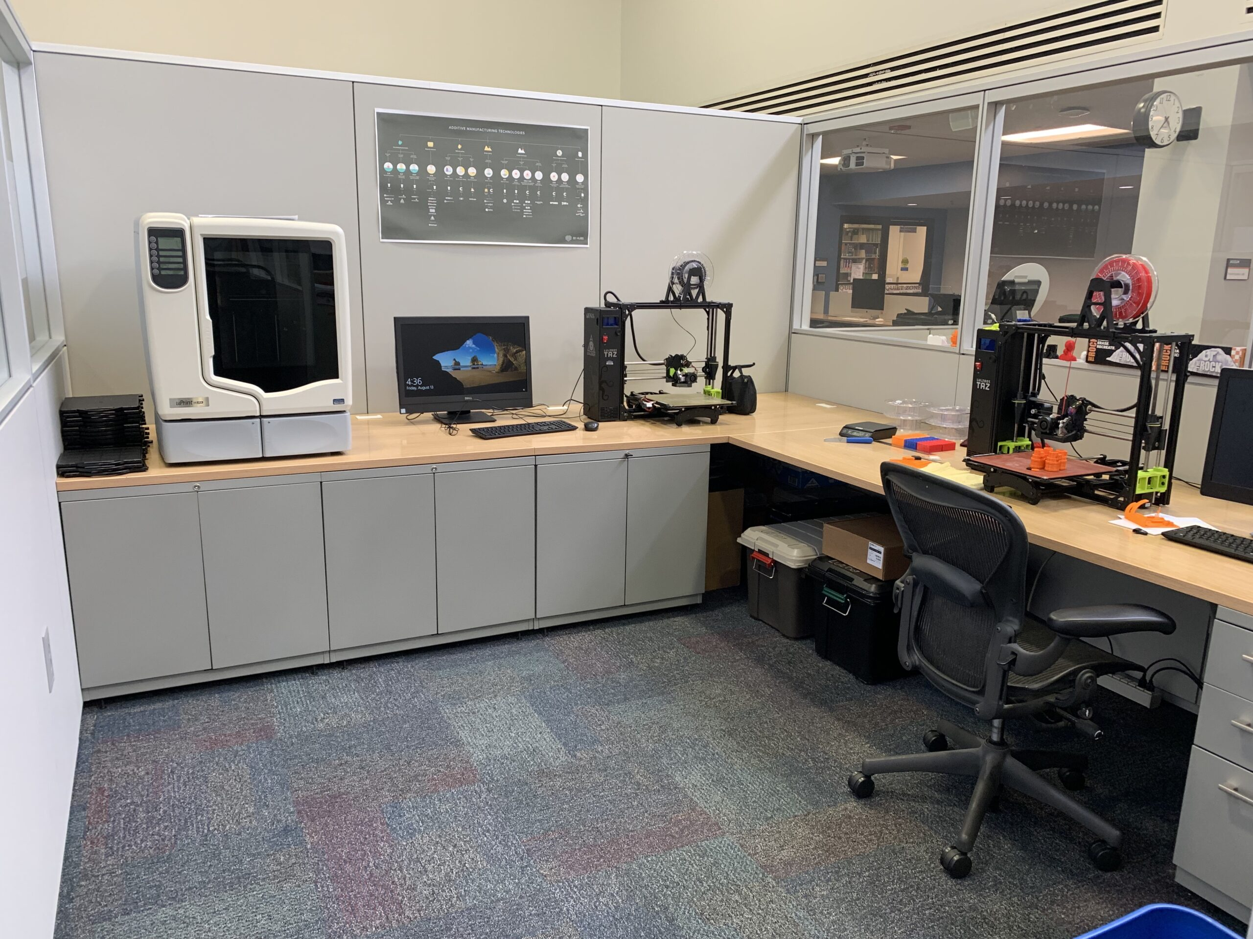 Makerspace area in Pendergrass Library. On the left there is the uPrint professional grade 3D printer. To the right, there are two Taz Lulzbot 6 printers.